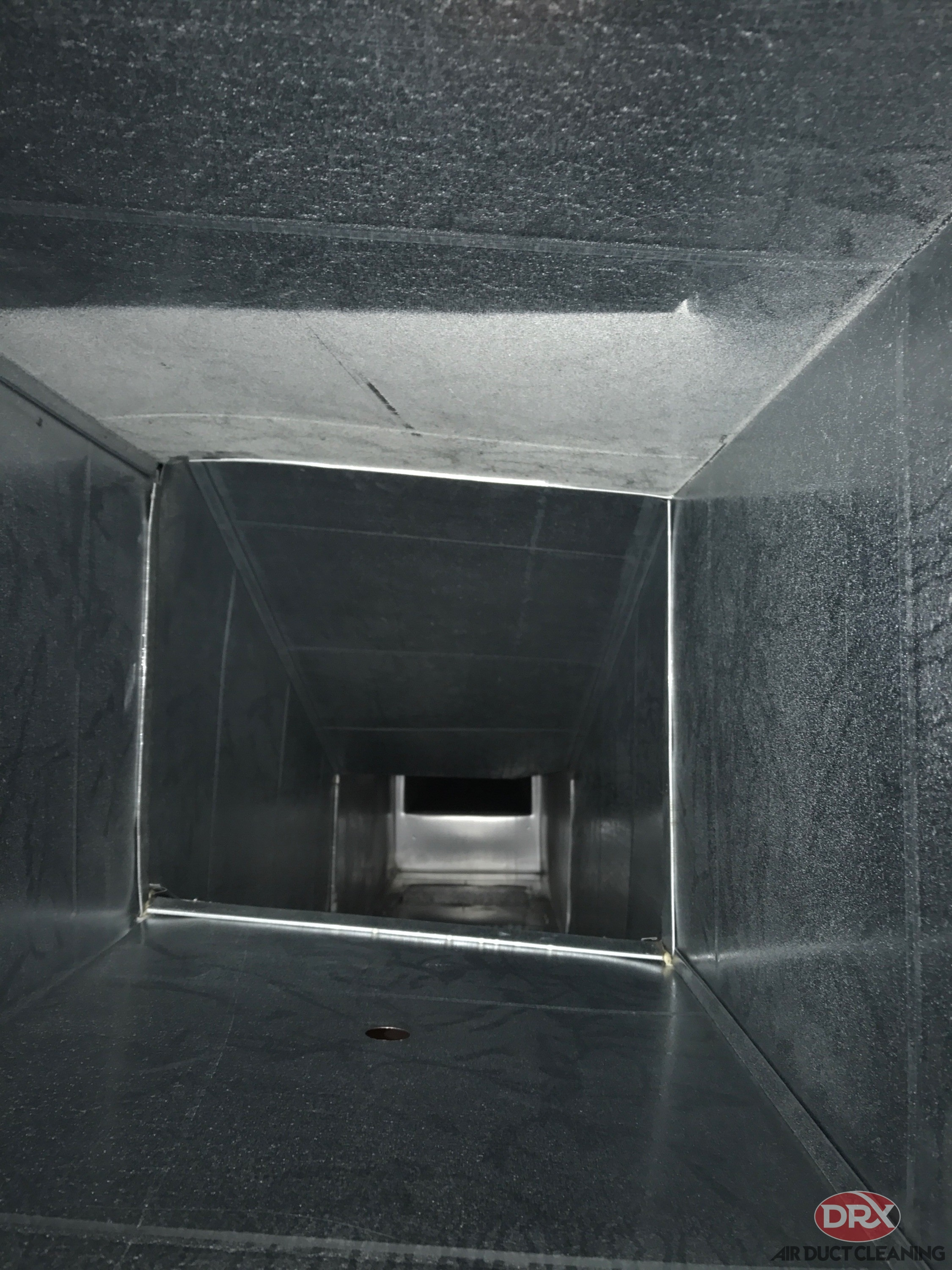 Duct cleaned by DRX ductwork professionals