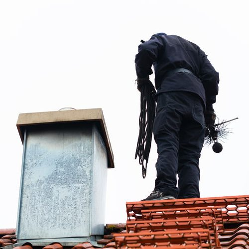Chimney Cleaning Services on Roof of Home & Working