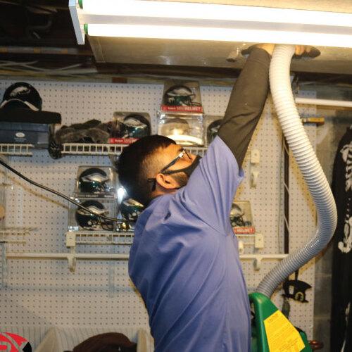 Technician Cleans Duct.