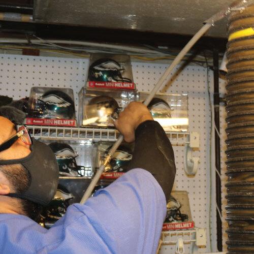 Technician Cleans Vent